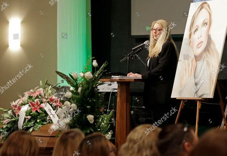 Gayle Inge, mother of country music star Mindy McCready, speaks during her daughter's funeral ceremony at the Crossroads Baptist Church in Fort Myers, Fla., on . McCready committed suicide Feb. 17 at her home in Arkansas, days after leaving a court-ordered substance abuse program
