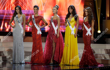 Stock Picture of Paulina Vega, Kaci Fennell, Diana Harkusha, asmin Verheijen, Nia Sanchez. The five final contestants, from left, Miss Colombia Paulina Vega, Miss Jamaica Kaci Fennell, Miss Ukraine Diana Harkusha, Miss Netherlands Yasmin Verheijen and Miss USA Nia Sanchez pose during the Miss Universe pageant in Miami