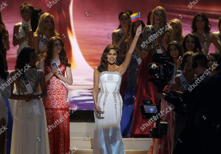 Reigning Miss Universe Gabriela Isler, center, waves to the crowd before crowning the new Miss Universe, Paulina Vega of Colombia, during the Miss Universe pageant in Miami
