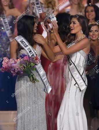 Gabriela Isler, Paulina Vega. Reigning Miss Universe Gabriela Isler, right, crowns the new Miss Universe, Paulina Vega of Colombia, left, during the Miss Universe pageant in Miami