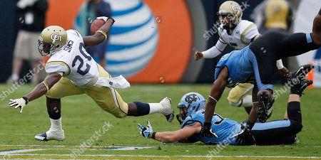 Georgia Tech running back David Sims (20) runs against North Carolina safety Jeff Schoettmer (34) during the first half of an NCAA football game, in Atlanta