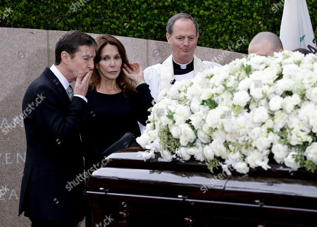 Stock Picture of Patti Davis, center, and Ronald Prescott Reagan, left, pause at the casket during graveside service for Nancy Reagan at the Ronald Reagan Presidential Library, in Simi Valley, Calif