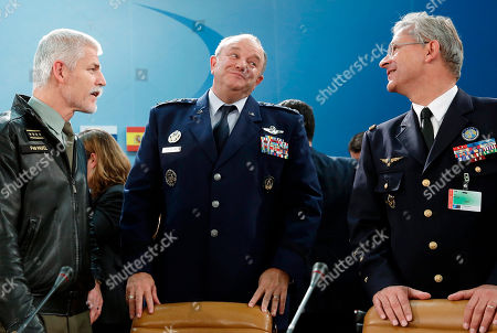 NATO Supreme Allied Commander, U.S. Air Force General Philip Breedlove, centre, speaks with Chairman of the NATO Military Committee, Czech Army General Petr Pavel, left, and Supreme Allied Commander Transformation (SACT), French Air Force General Denis Mercier, at the start of the NATO Ministerial Meeting on the South, Partnerships, and Defense Capacity at NATO Headquarters in Brussels