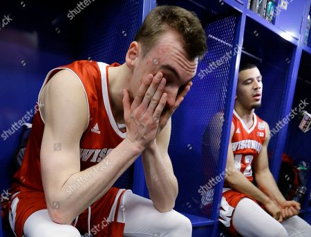 Stock Picture of Wisconsin's Sam Dekker, left, and Traevon Jackson sit in the locker room after their team's 68-63 loss to Duke in the NCAA Final Four college basketball tournament championship game, in Indianapolis