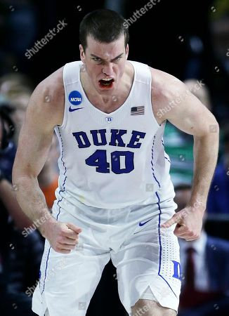 Duke center Marshall Plumlee (40) lets out a yell as he heads up court after hitting a basket against North Carolina-Wilmington in the second half during the first round of the NCAA college men's basketball tournament in Providence, R.I., . Plumlee had 23 points as Duke defeated North Carolina-Wilmington 93-85