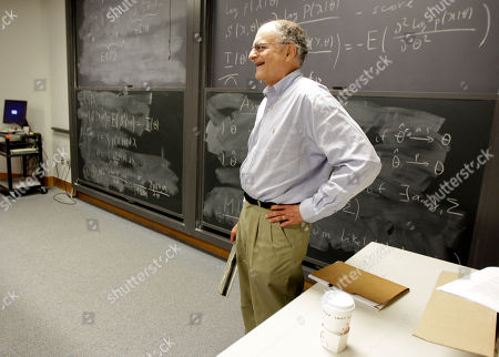 Thomas Sargent, 68, a professor at Princeton University, pauses as his students clap in his honor during class, in Princeton, N.J. Sargent won the Nobel economics prize on Monday for research that sheds light on the cause-and-effect relationship between the economy and policy instruments such as interest rates and government spending. Christopher Sims, also a professor at Princeton, was also awarded the honor