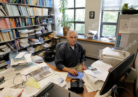 Christopher Sims, 68, a professor at Princeton University, poses for The Associated Press in his office, in Princeton, N.J. Sims won the Nobel economics prize on Monday for research that sheds light on the cause-and-effect relationship between the economy and policy instruments such as interest rates and government spending. Thomas Sargent, a professor at New York University who also teaches at Princeton, was also awarded the honor