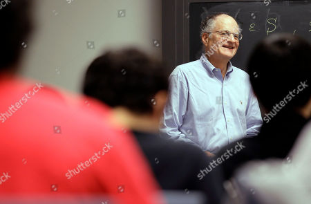 Thomas Sargent, 68, a professor at Princeton University, teaches a class, in Princeton, N.J. Sargent won the Nobel economics prize on Monday for research that sheds light on the cause-and-effect relationship between the economy and policy instruments such as interest rates and government spending. Christopher Sims, also a professor at Princeton, was also awarded the honor