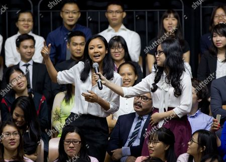 Vietnamese rapper Suboi, left, raps during a town hall event hosted by U.S. President Barack Obama for the Young Southeast Asian Leadership Initiative (YSEALI) at the GEM Center in Ho Chi Minh City, Vietnam, . Obama is wrapping up his visit to Vietnam before traveling to Japan for the G-7 summit and a visit to Hiroshima