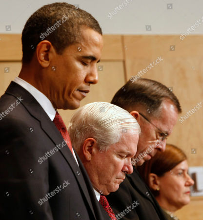 Barack Obama, Michael Mullen, Robert Gates, Frances Wilson. President Barack Obama, and others, bow their heads in prayer prior to the president delivering remarks at the dedication of Abraham Lincoln Hall at the National Defense University in Washington, . From left are, the president, Defense Secretary Robert Gates, Joint Chiefs Chairman Adm. Michael Mullen and Lt. Gen. Frances Wilson