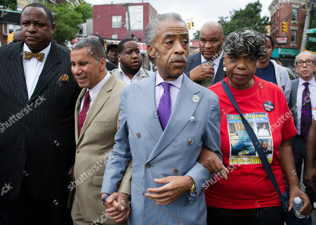 Al Sharpton, David Paterson, Gwen Carr. The Rev. Al Sharpton, second from right, walks with former New York Gov. David Paterson, second from left, and Gwen Carr, right, mother of Eric Garner, as they arrive before a march to protest the death of Eric Garner, in the Staten Island borough of New York. The afternoon rally and march was led by Sharpton and relatives of Garner, who died July 17 after a New York Police Department officer took him to the ground with a banned tactic in a confrontation captured on video