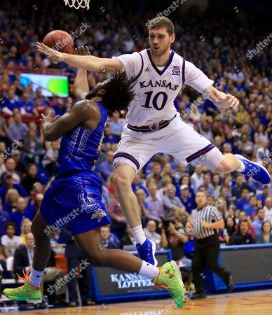 David Jenkins Jr., Sviatoslav Mykhailiuk. South Dakota State guard David Jenkins Jr. (5) is fouled by Kansas guard Sviatoslav Mykhailiuk (10) during the second half of an NCAA college basketball game in Lawrence, Kan., . Kansas won 98-64