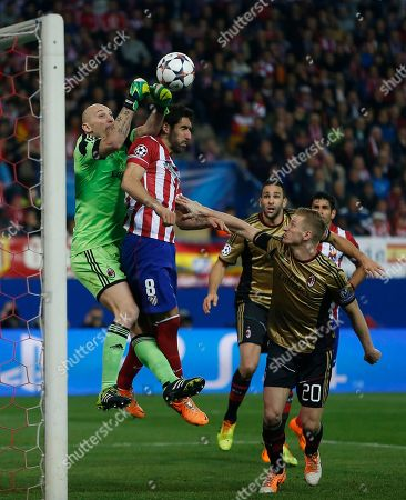 Raul Garcia, Christian Abbiati. AC Milan goalkeeper Christian Abbiati, left, in action with Atletico's Raul Garcia, second left, during a Champions League last 16 second leg soccer match between Atletico Madrid and AC Milan, at the Vicente Calderon stadium in Madrid