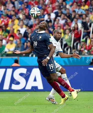 Honduras' Wilson Palacios runs into France's Paul Pogba during the group E World Cup soccer match between France and Honduras at the Estadio Beira-Rio in Porto Alegre, Brazil, . Palacios was booked for the second time and ejected from the match