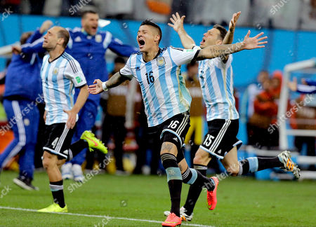 Argentine players react after Maxi Rodriguez scored the winning goal during a penalty shootout after extra time during the World Cup semifinal soccer match between the Netherlands and Argentina at the Itaquerao Stadium in Sao Paulo Brazil, . Argentina defeated the Netherlands 4-2 in a penalty shootout after a 0-0 tie to advance to the finals