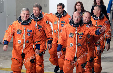 Mark Kelly, Greg Johnson, Mike Fincke, Drew Feustel, Roberto Vittori, Greg Chamitoff. The crew of space shuttle Endeavour, clockwise from left, British born U.S. astronaut, pilot Greg Johnson, European Space Agency astronaut Roberto Vittori, of Italy, Canadian born U.S. astronaut Greg Chamitoff, mission specialist Drew Feustel, mission specialist Mike Fincke and commander Mark Kelly, leave the Operations and Checkout building on their way to Pad 39A to board the shuttle at the Kennedy Space Center Visitors Center in Cape Canaveral, Fla
