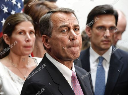 John Boehner, Eric Cantor, Mary Bono Mack. House Speaker John Boehner of Ohio, flanked by House Majority Leader Eric Cantor, R-Va., right, and Rep. Mary Bono Mack, R-Calif., pauses during a news conference on Capitol Hill in Washington