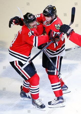 Brad Richards, Patrick Kane. Chicago Blackhawks' Patrick Kane, right, is congratulated by teammate Brad Richards after scoring during the third period in Game 6 of the NHL hockey Stanley Cup Final series against the Tampa Bay Lightning, in Chicago