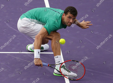 Andy Murray, Grigor Dimitrov. Grigor Dimitrov, of Bulgaria, returns to Andy Murray during their match at the Miami Open tennis tournament, in Key Biscayne, Fla