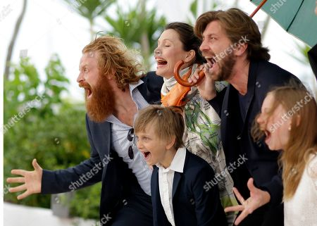 From left, actor Kristofer Hivju, actor Vincent Wettergren, actress Lisa Loven Kongsli, director Ruben Ostlund, and actress Clara Wettergren pose for photographers during a photo call for Turist at the 67th international film festival, Cannes, southern France