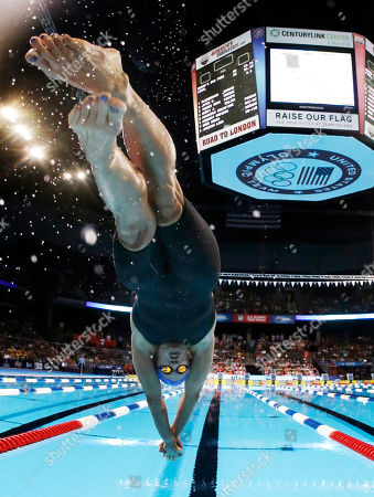 Dara Torres dives at the start of the women's 50-meter freestyle final at the U.S. Olympic swimming trials, in Omaha, Neb. Jessica Hardy won the final
