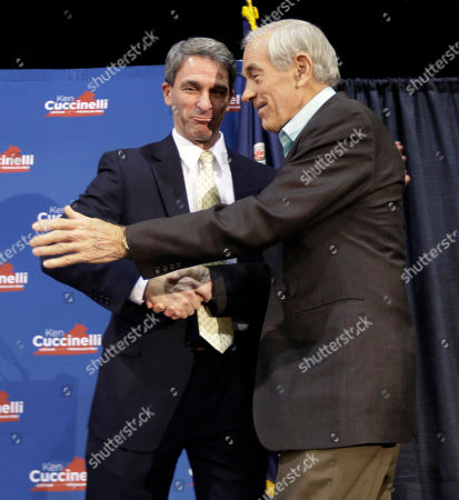 Ken Cuccinelli, Ron Paul. Republican gubernatorial candidate, Virginia Attorney General Ken Cuccinelli, left, greets former U.S. Rep. Ron Paul during a rally in Richmond, Va., . Cuccinelli faces Democrat Terry McAuliffe in Tuesday's election