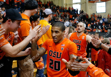 Gary Payton II, Gligorjie Rakocevic. Oregon State's Gary Payton II, front, and Gligorije Rakocevic, rear, high five fans after defeating Washington State 69-49 in the final NCAA college home basketball game in Corvallis, Ore., on
