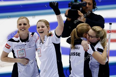 Alina Paetz, Nadine Lehmann, Marisa Winkelhausen, Nicole Schwaegli. Swiss curlers, from left, Nadine Lehmann, Marisa Winkelhausen, Nicole Schwaegli and Alina Paetz celebrate after winning their final match against Canada at the World Women's Curling Championship in Sapporo, northern Japan, . Switzerland defeated Canada 5-3 and won the championship title