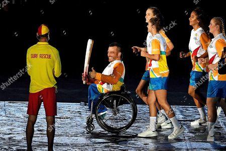 Australian wheelchair racer Kurt Fearnley holds the Queen's Baton