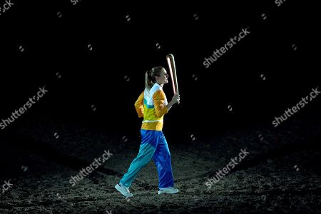 Australian hurdler Sally Pearson carries the Queen's Baton
