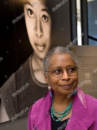 Alice Walker stands in front of a picture of herself from 1974 as she tours her archives at Emory University, in Atlanta. Emory University is unveiling the literary archives of the Pulitzer Prize-winning author for the first time since she donated the collection to the Atlanta school a year ago
