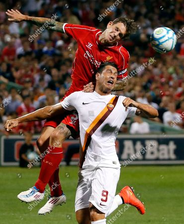Daniel Agger, Marco Borriello. Liverpool FC defender Daniel Agger, top, challenges AS Roma's Marco Borriello (9) for the ball during a friendly soccer match at Fenway Park in Boston