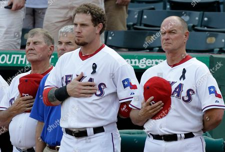 Jackie Moore, Johnny Narron, Josh Hamilton, Jamie Reed. Texas Rangers' Jackie Moore, from left, athletic trainer Jamie Reed, Josh Hamilton and coach Johnny Narron, right, stand during a moment of silence before the start of a baseball game against the Oakland Athletics, in Arlington, Texas. A fan, Shannon Stone, fell to his death reaching for a ball tossed to him by the Rangers' Josh Hamilton, at Thursday's game between the two clubs