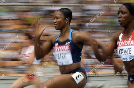 Carmelita Jeter, Jeanette Kwakye. USA's Carmelita Jeter competes in a heat of the women's 100-meter race at the World Athletics Championships in Daegu, South Korea, . Right is Jeanette Kwakye, of Britain