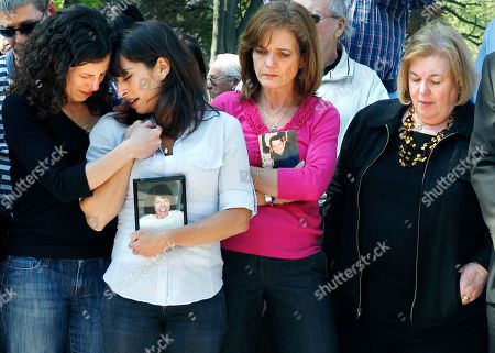 Stock Image of Danielle and Carie Lemack, Christy Coombs, Irene Ross. Massachusetts family members, from left, sisters Danielle and Carie Lemack who lost their mother Judy Larocque; Christy Coombs who lost her husband Jeffrey; and Irene Ross who lost her brother Richard Ross, all on ill-fated Flight 11 from Logan Airport on 9/11 grieve in Boston during a moment of silence at the Garden of Remembrance, a memorial dedicated to the 206 Massachusetts victims of September 11, 2001. The event was held in the wake of news of the death of Osama bin Laden