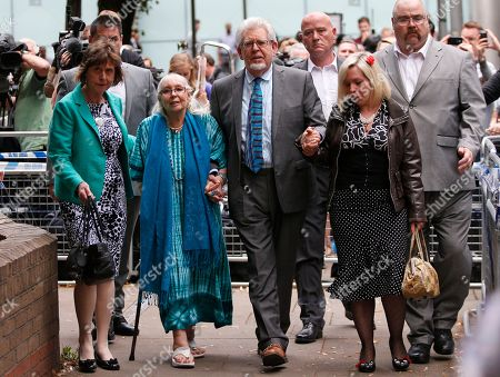 Veteran entertainer Rolf Harris, centre, accompanied by members of his family, daughter Bindi, right, wife Alwen, 2nd left, and niece Jenny, left, leave the Southwark Crown Court in London, . A jury Monday found Australian-born Harris guilty of 12 counts of indecent assault. The 84-year-old was convicted of indecent assault on four victims aged 19 or under between 1968 and 1986