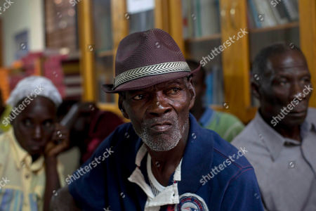 """Amigal Enavier, front, 70, who was imprisoned for 8 years during Haiti's former dictator Jean-Claude """"Baby Doc"""" Duvalier, attends a press conference in Port-au-Prince, Haiti, . The appeals process for parties involved in the high-profile case against former dictator Jean-Claude Duvalier has begun, Haiti's attorney general said Monday. The appeals process comes after a judge recommended that the former strongman knows as """"Baby Doc"""" be tried for alleged financial crimes in a lesser court, and not for the human rights abuses associated with his brutal regime in the 1970s and 1980s"""