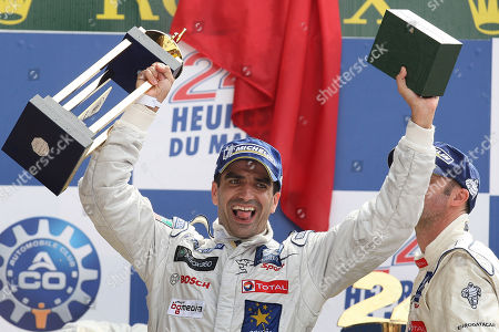 Spanish driver Marc Gene celebrates on the podium after the 77th edition of the Le Mans 24 Hours endurance race, in Le Mans, western France, . Marc Gene of Spain and Peugeot won the 24 Hours of Le Mans on Sunday, ending Audi's five-year domination. The diesel-powered Peugeot No. 9 was one of the few cars to have a trouble-free run in the world's most famous endurance race. Gene, David Brabham of Britain and Alexander Wurz of Austria completed 382 laps in 24 hours, one lap more than the Peugeot No. 8 driven by French trio Sebastien Bourdais, Franck Montagny and Stephane Sarrazin