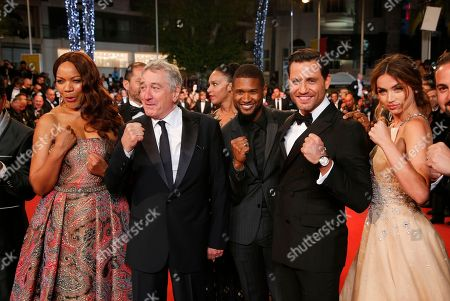 Actress Ana De Armas, actors Edgar Ramirez, Usher Raymond IV, Robert De Niro and his wife Grace Hightower, from right, pose for photographers upon arrival at the screening of the film Hands of Stone at the 69th international film festival, Cannes, southern France
