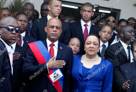"Michel Martelly, Sophia Martelly. Haiti's new President Michel Martelly stands with his wife Sophia and their children as the Haitian national anthem is played in Port-au-Prince, Haiti, . The 50-year-old performer known to Haitians as ""Sweet Micky"" was swept to power in a March 20 presidential runoff by Haitians tired of past leaders who failed to provide even basic services, such as decent roads, water and electricity in the Western Hemisphere's poorest country"