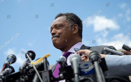 Rev. Jesse Jackson pauses as he he speaks to media outside federal court in Washington, after his son, former Illinois Rep. Jesse Jackson Jr., was sentenced to two and a half years in prison after pleading guilty to scheming to spend $750,000 in campaign funds on TV's, restaurant dinners, an expensive watch and other costly personal items. Jackson Jr.'s wife Sandra Jackson received a sentence of one year