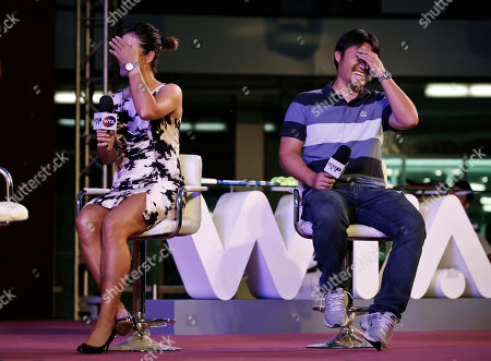 Li Na, Jiang Shan. Chinese tennis player Li Na, left, and her husband Jiang Shan react after watching a video clips of them during an event with her fans organized by Women Tennis Association (WTA) in Beijing, China, . Li was doing her best to keep a low profile in China, despite returning home to a hero's welcome after securing the country's first Grand Slam title at the French Open