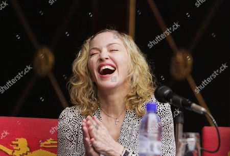 US singer Madonna laughs, during her meeting with Malawian President Peter Mutharika, at the State House, in Lillongwe, Malawi, Friday, Nov, 28, 2014. Mutharika thanked Madonna for agreeing to fund the construction of a new state of the art Paediatric Surgery and Intensive Care Unit in the country. Madonna is in the African country of Malawi for the first time since she had a falling out with the former president Joyce Banda