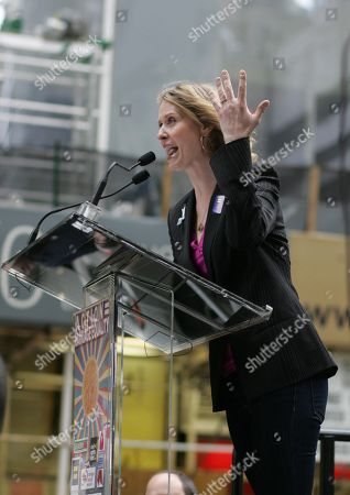 Actress Cynthia Nixon shows an engagement ring from her partner Christine Marinoni at an Action=Marriage Equality rally in midtown New York