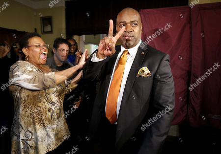 Newark mayoral candidate Ras Baraka, right, is greeted by supporters after casting his vote, in Newark, N.J. Tuesday's election will decide whether Shavar Jeffries, a former state assistant attorney general, or Baraka, a city councilman, will take over the seat Cory Booker occupied from 2006 until October 2013, when he won a special election to succeed U.S. Sen. Frank Lautenberg, who died in office