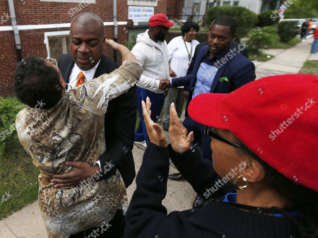 Newark mayoral candidate Ras Baraka, second from left, is greeted by supporters before casting his vote, in Newark, N.J. Tuesday's election will decide whether Baraka, a Newark city councilman, or opponent Shavar Jeffries, a former state assistant attorney general, will take over the seat Cory Booker occupied from 2006 until October 2013, when he won a special election to succeed U.S. Sen. Frank Lautenberg, who died in office