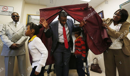 Shavar Jeffries, Naomi Jeffries, Kaleb Jeffries. Newark mayoral candidate Shavar Jeffries, center, walks out of a voting booth with his children, Naomi Jeffries, 7, left, and Kaleb Jeffries, 9, after casting his vote, in Newark, N.J. The election will decide whether Jeffries, a former state assistant attorney general, or his opponent, City Councilman Ras Baraka, will take over the seat Cory Booker occupied from 2006 until October 2013, when he won a special election to succeed U.S. Sen. Frank Lautenberg, who died in office