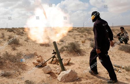 A Libyan rebel shells pro Gadhafi forces with mortar fire, along the front line outside the eastern town of Brega, Libya . Libya conceded Thursday that Foreign Minister Moussa Koussa had resigned but claimed that it was a personal decision driven by health problems, not a sign that the embattled regime is cracking at the highest levels