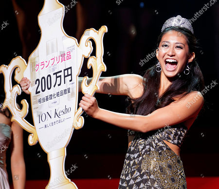 Maria Kamiyama shows off her award certificate after she was selected the Miss Universe Japan in Tokyo, . The 24-year-old sales clerk from Osaka will represent Japan in the final selections scheduled for Sept. 12, 2011 in Sao Paulo, Brazil