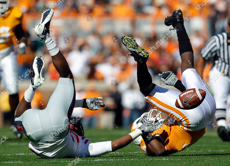 Eric Gordon, Ja-Mes Logan. Tennessee cornerback Eric Gordon, right, breaks up a pass intended for Mississippi wide receiver Ja-Mes Logan, left, in the first quarter of an NCAA college football game on in Knoxville, Tenn
